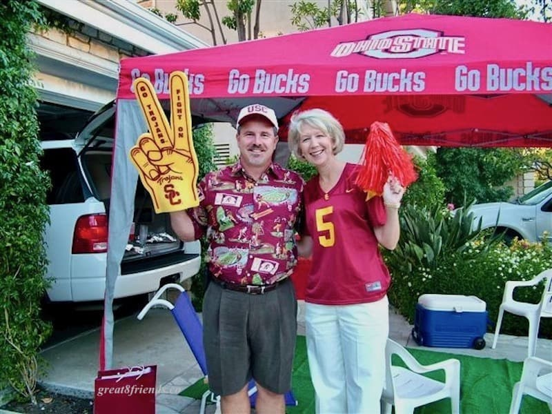 Couple in USC shirts with cheer gear.