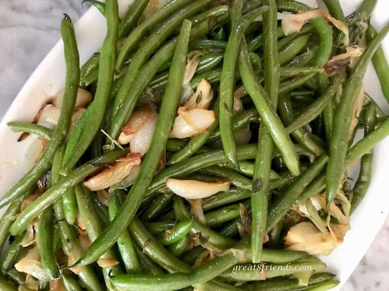 Overhead close up of green beans and onions.
