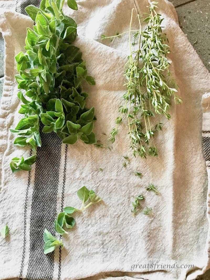 Fresh herbs on a kitchen towel.