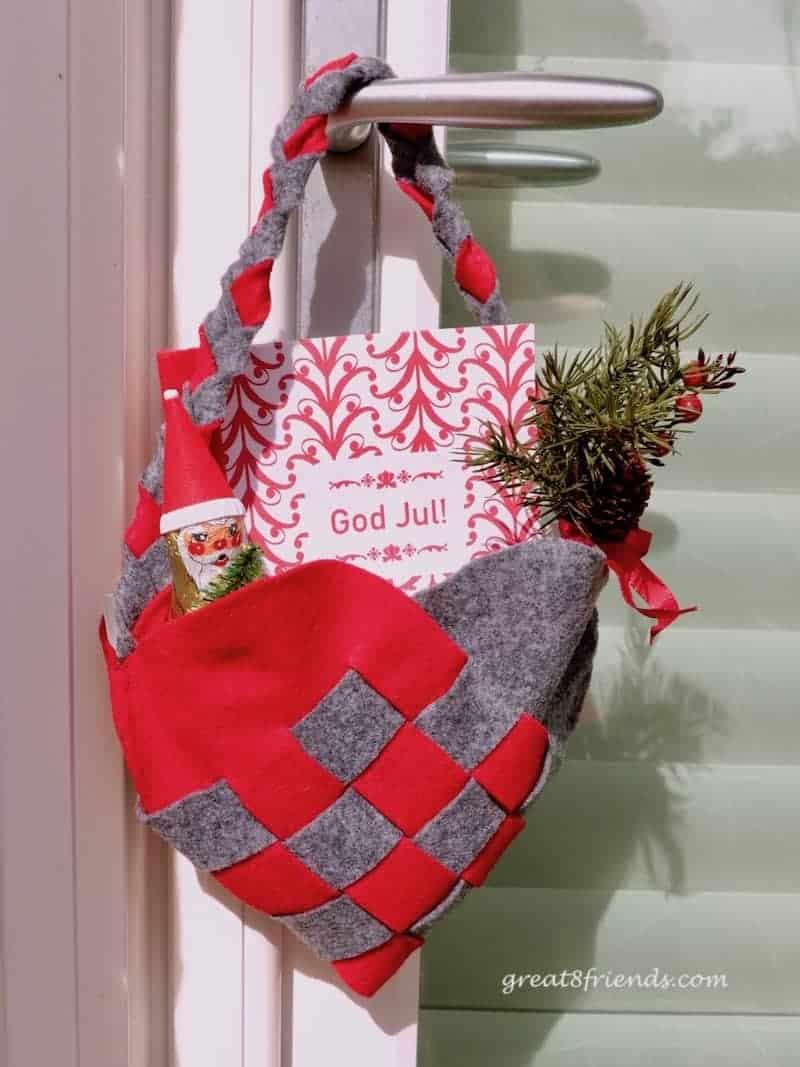 A Danish Christmas dinner invitation felt heart hanging on doorknob