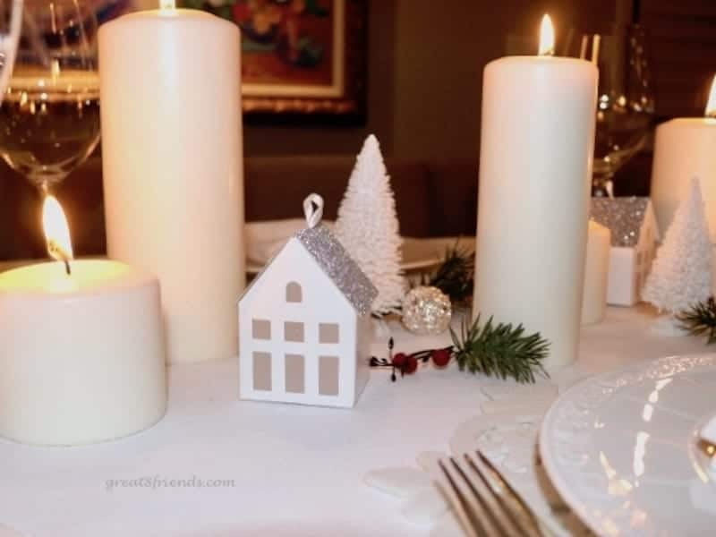A Danish Christmas Dinner centerpiece white candles small house