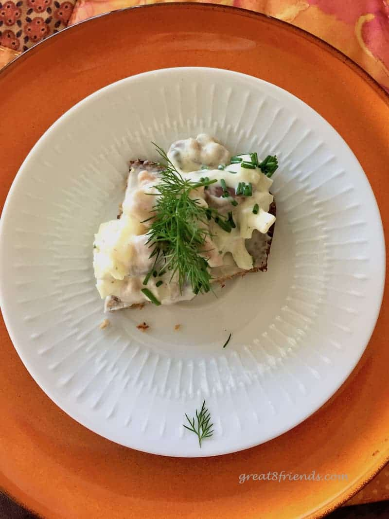 Overhead shot of one pickled herring salad open faced sandwich.