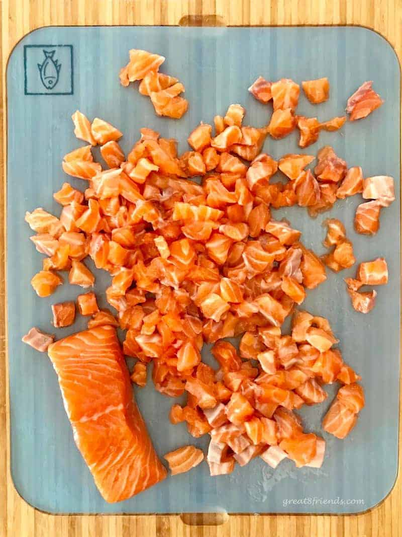 Chopped fresh raw salmon for salmon sliders.
