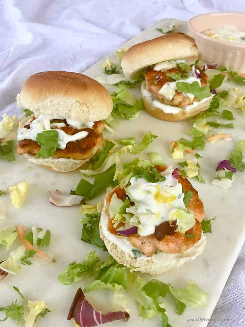 These Salmon Sliders with a Tangy Lemony Yogurt Sauce are the perfect size to serve as appetizers or as a delicious main course.