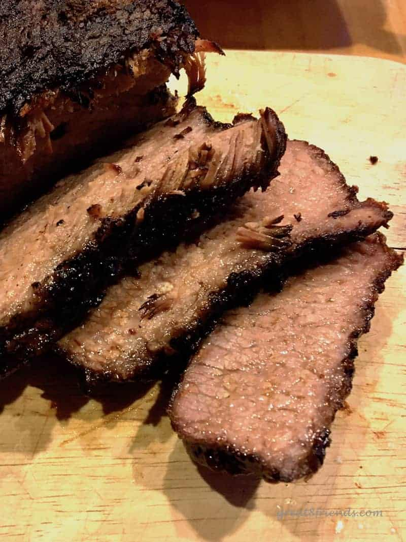 A close up of sliced smoked brisket.