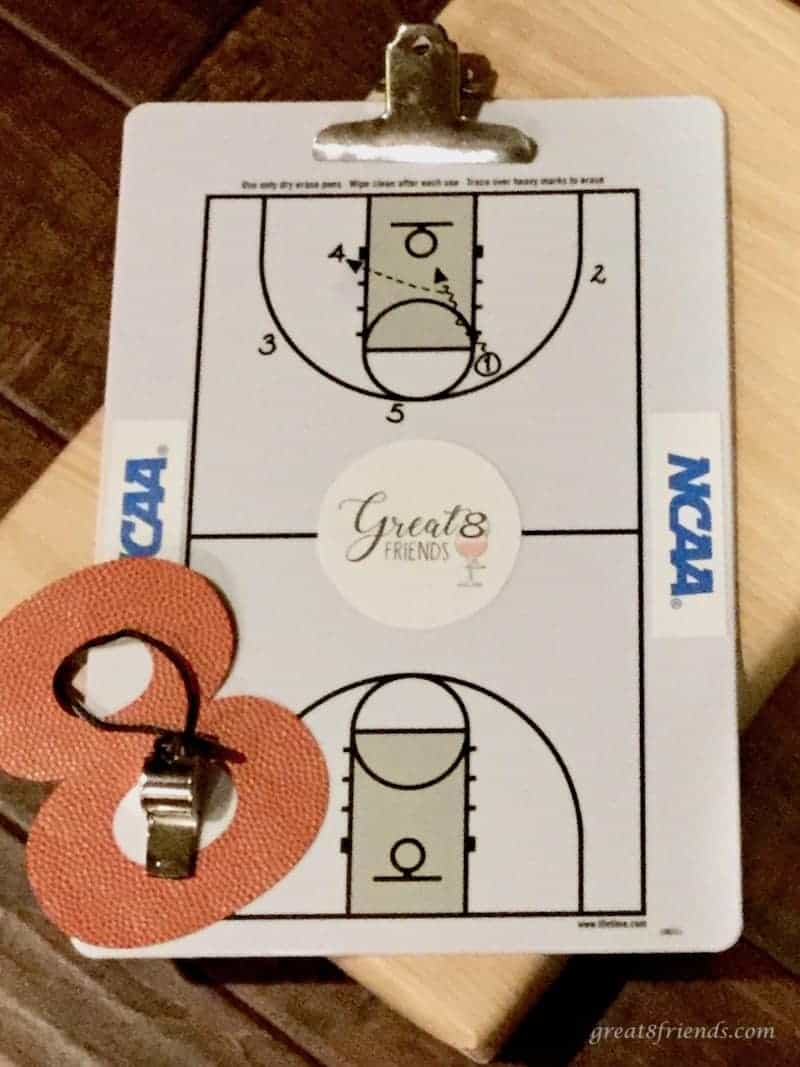 Coach's clipboard for NCAA with a cut out 8 and whistle.