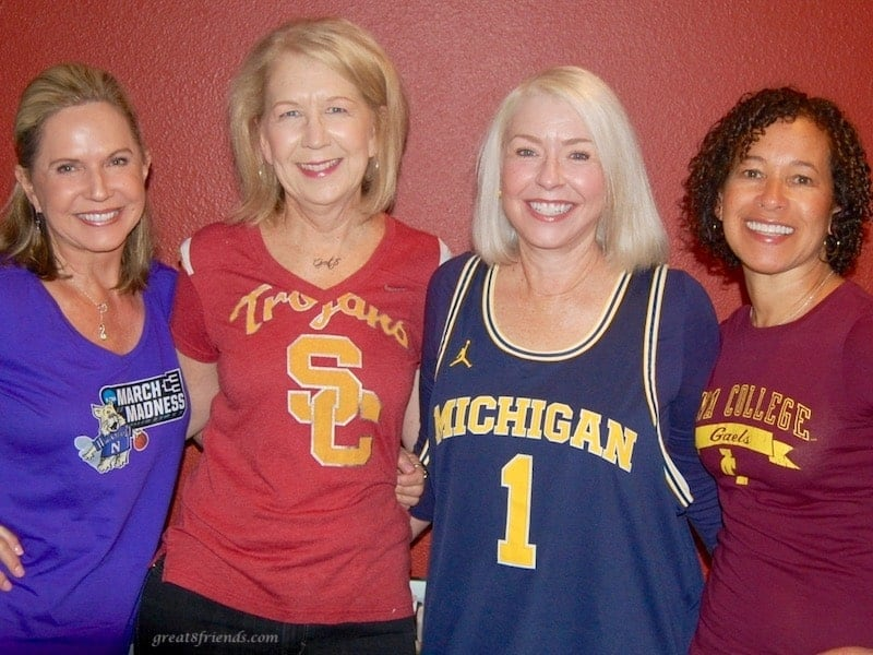 The four of us each in a college shirt, Northwestern March Madness, USC Trojans t-shirt, Michigan basketball tank, Seton Hall College t-shirt.