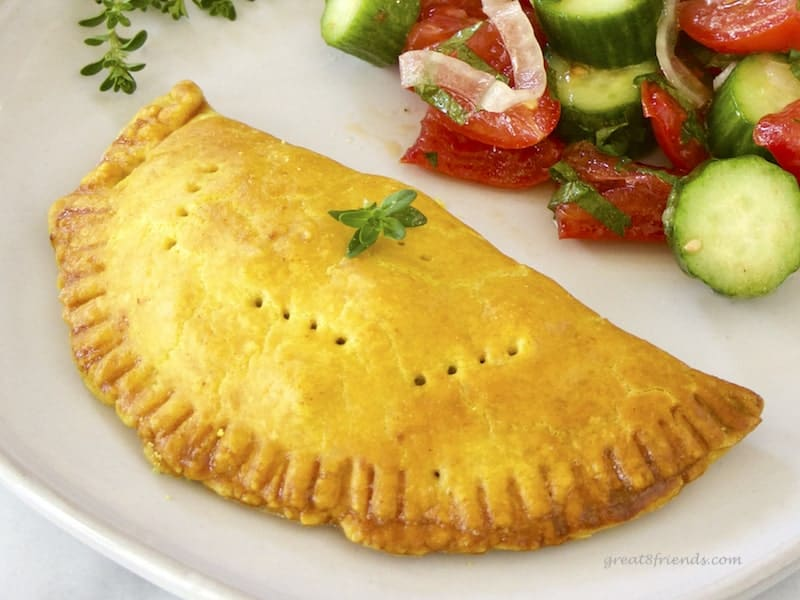 One meat pie with a salad