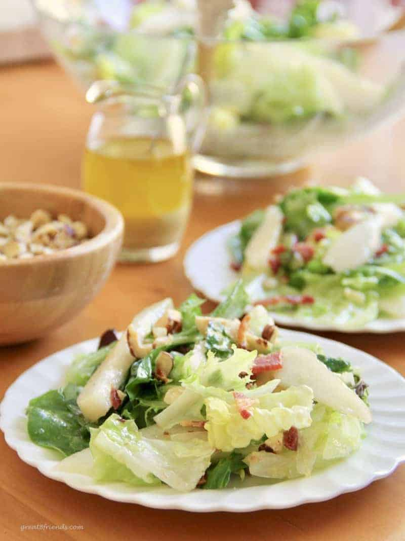 This Pear Hazelnut Green Salad combines simple but delicious flavors. Pears, hazelnuts, bacon, greens and a tasty dressing make this easy salad a hit.