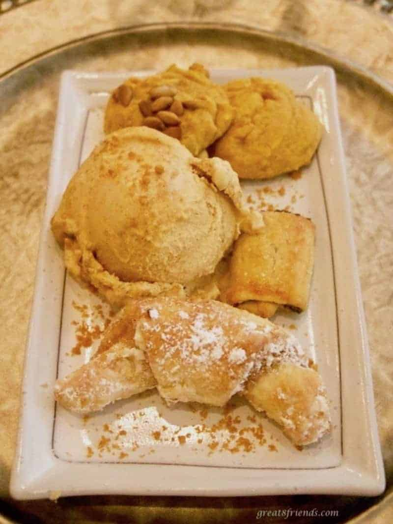 Pecan walnut crescent cookies served with pumpkin ice cream.