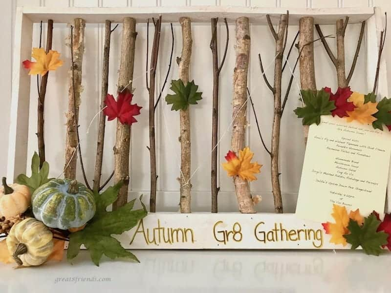 Great Eight Celebrates Autumn Invitation displayed with framed twigs and autumn leaves.