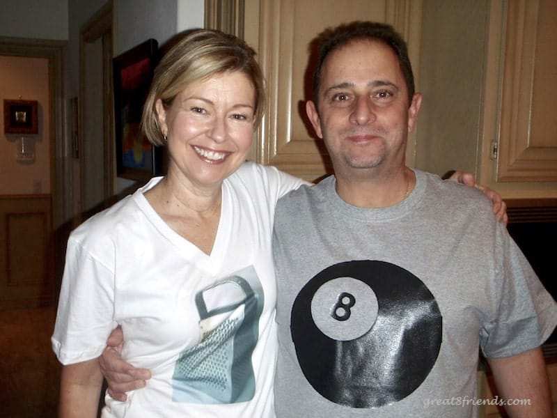 Anna wearing a white t-shirt with a photo of a grater and Vince wearing a gray t-shirt with picture of 8-ball - the Grate 8.