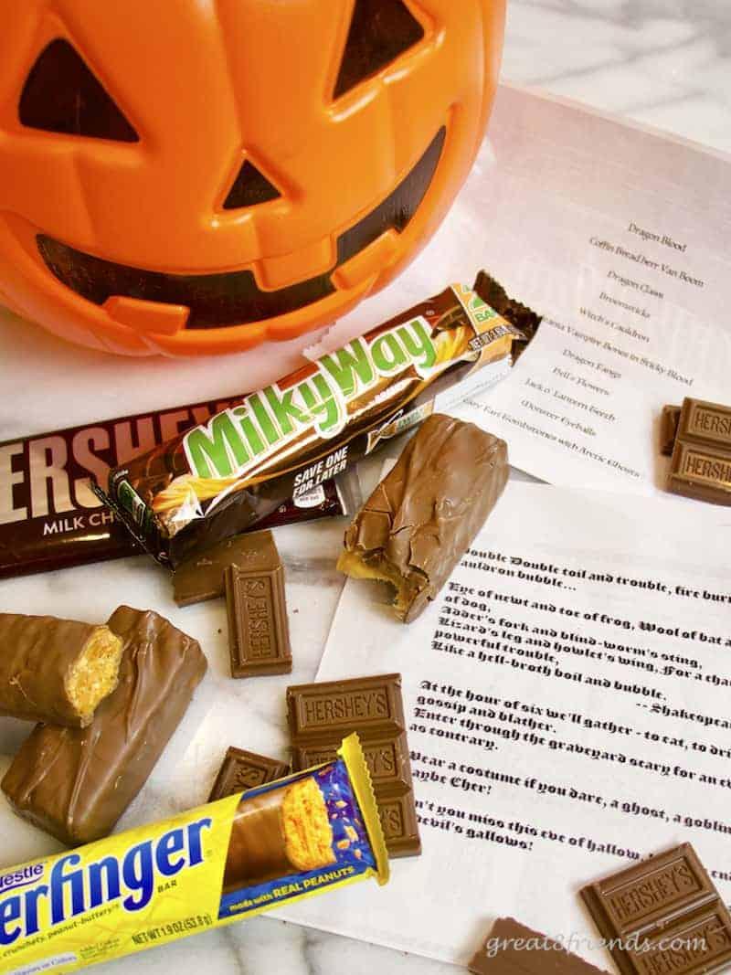 Halloween Haunt invitations, a plastic pumpkin, candy bars and the invitations.