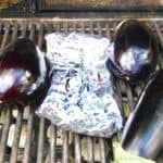 Eggplant cooking on the BBQ grill for the Baba Ganoush recipe.
