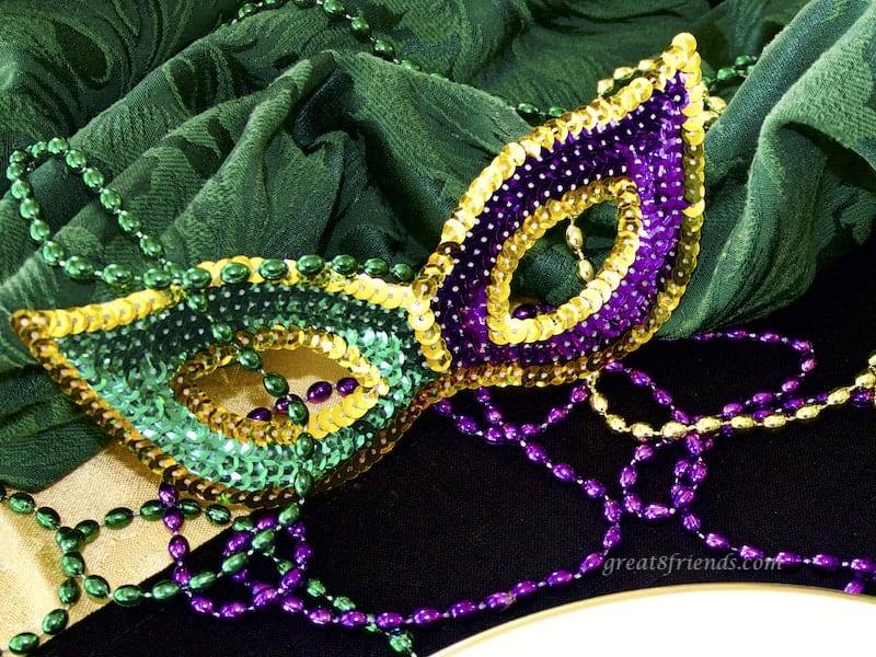 Mardi Gras Mask and beads.