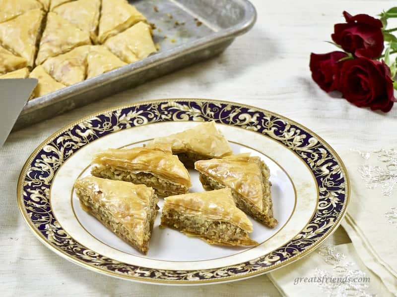 Plate of homemade Lebanese Baklava with tray in background