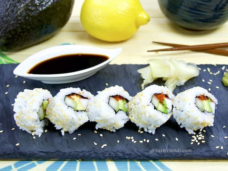 California Roll sliced with condiments and chopsticks