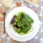 Mixed greens with lemon vinaigrette and arugula oil