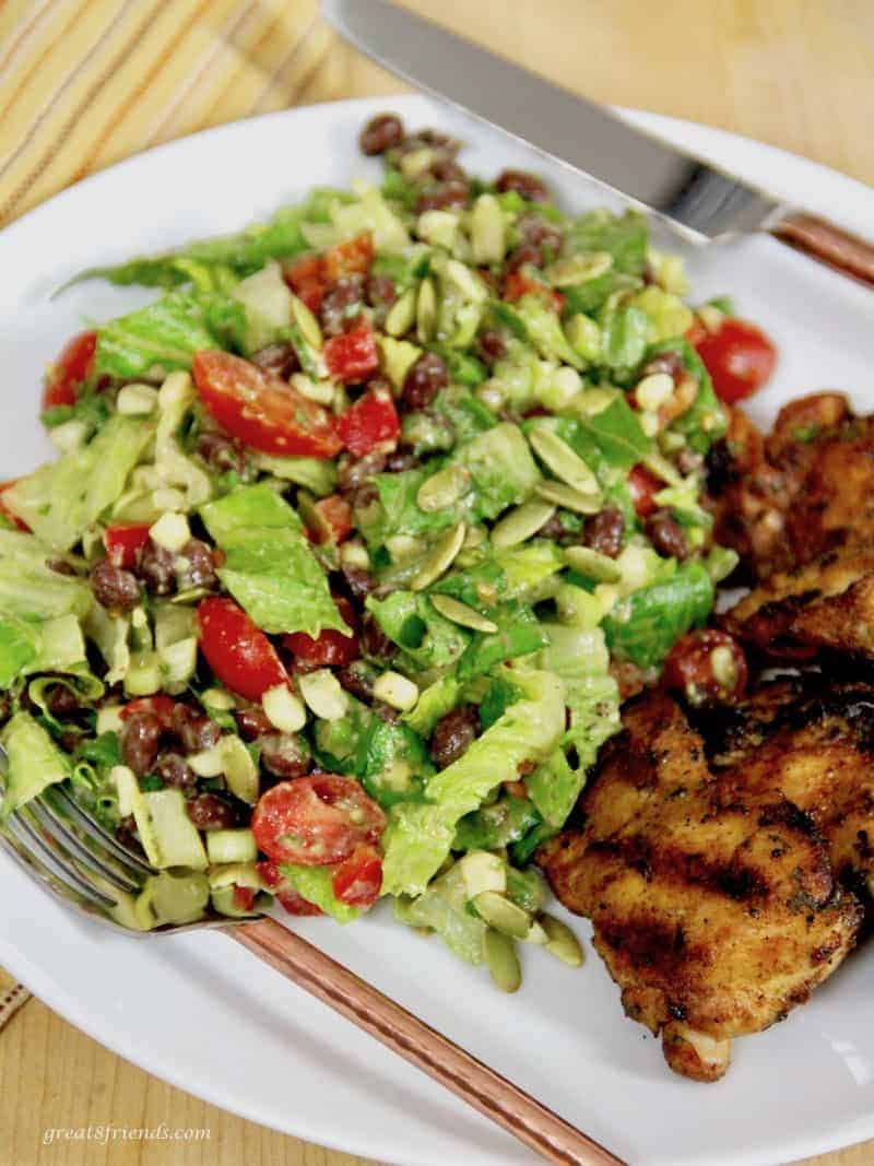 Black Bean Salad with Avocado Lime dressing served with grilled chicken thighs.