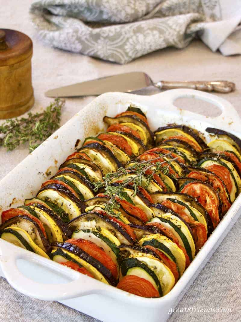 Provençal Vegetable Tian vertical photo in white casserole with silver server