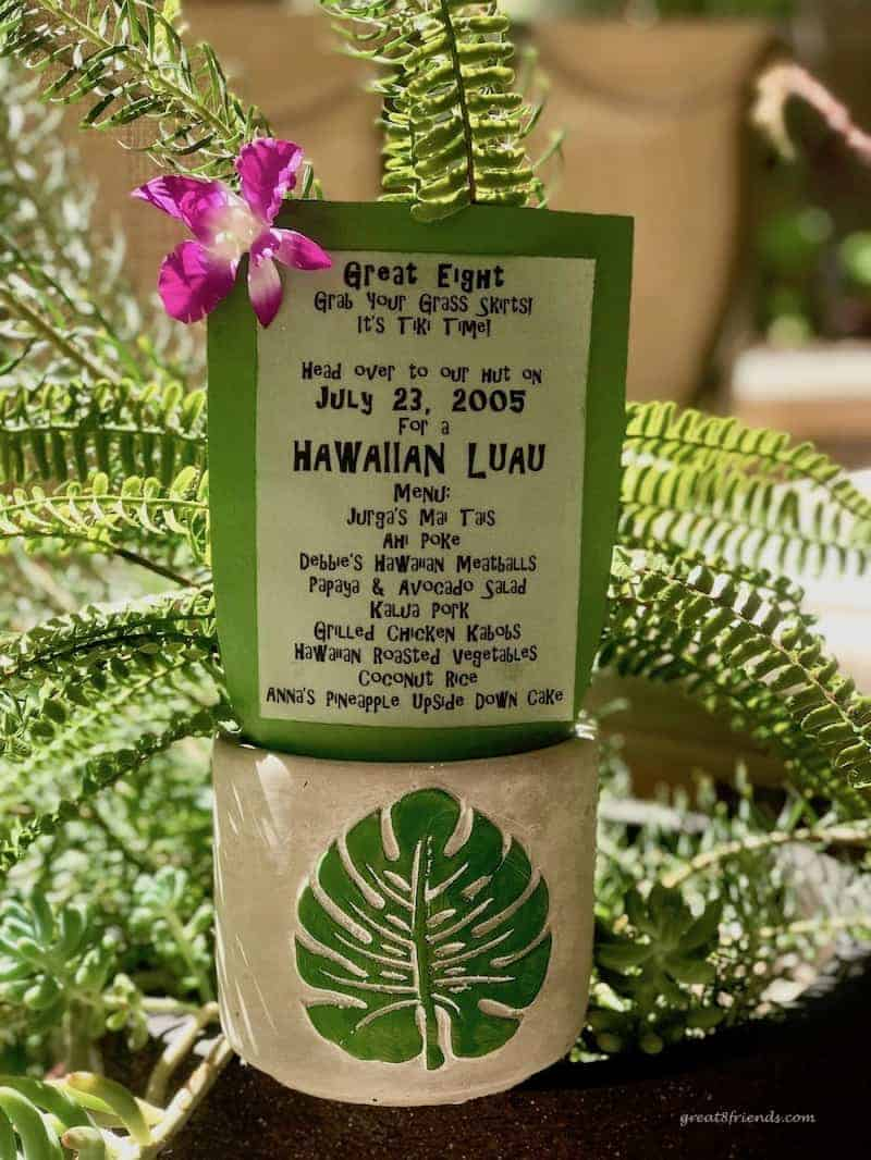 Hawaiian Luau dinner party invite on paper included with a fern in a ceramic vase with a fern leaf on it.
