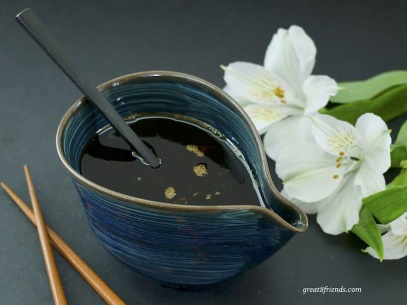 Teriyaki Sauce in blue ceramic dish with spoon