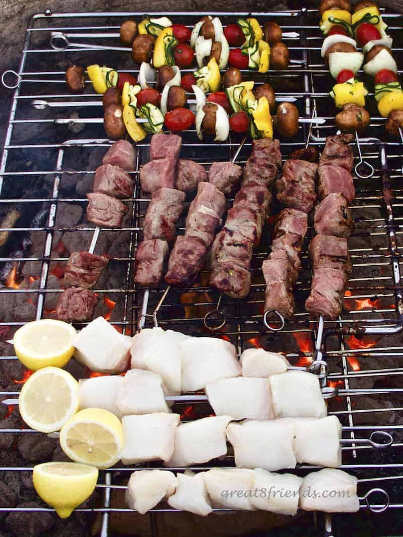 The grill at the beach barbecue with the veggie, beef and fish skewers.