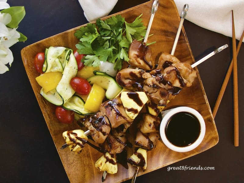 Teriyaki Chicken Skewers overhead shot on wooden plate with grilled veggies