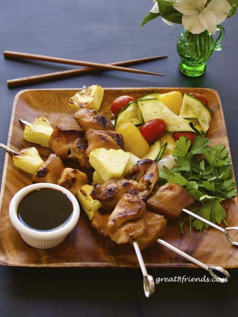 Teriyaki Chicken Skewers with chopsticks