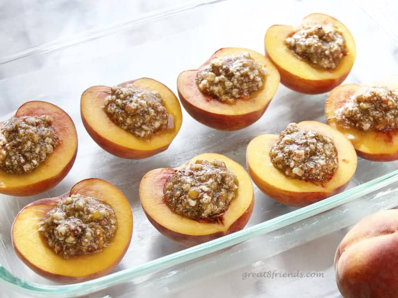 Peaches stuffed and ready to bake.