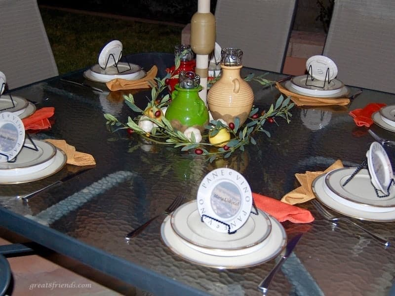 Table set for an Italian dinner on the patio table.