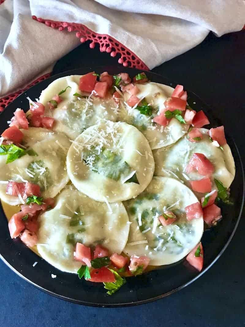Mushroom and Ricotta Ravioli on a round plate.