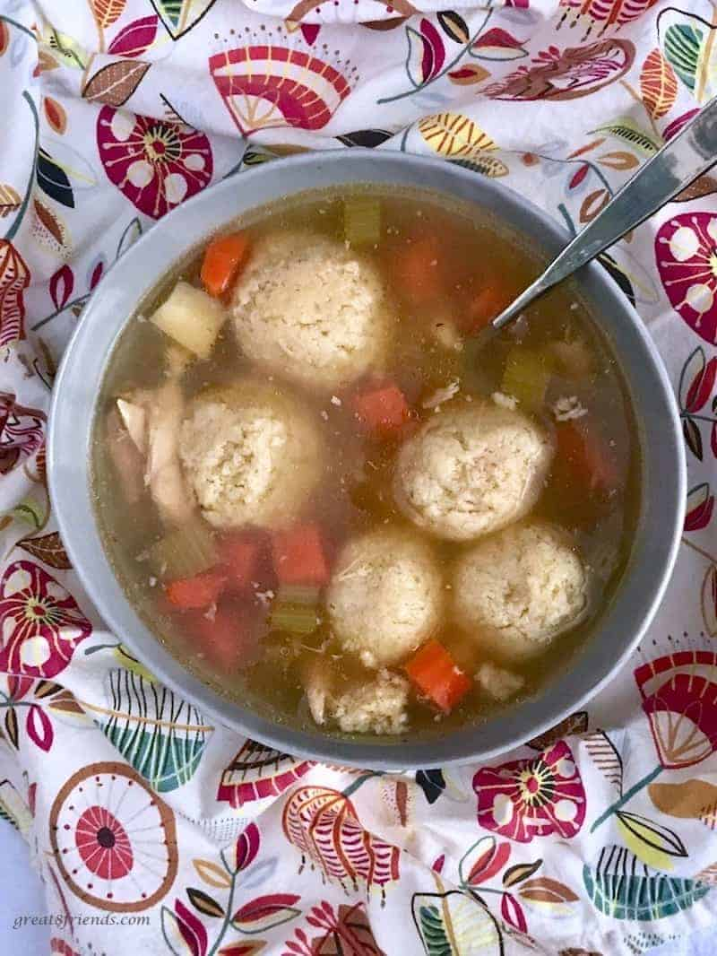 Overhead photo of a bowl of matzo ball soup.