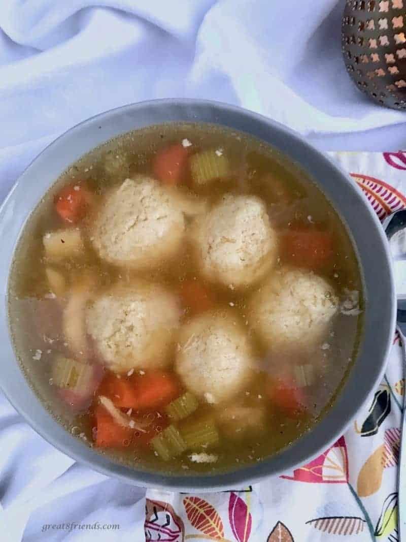 Overhead photo of a bowl of matzo ball soup.