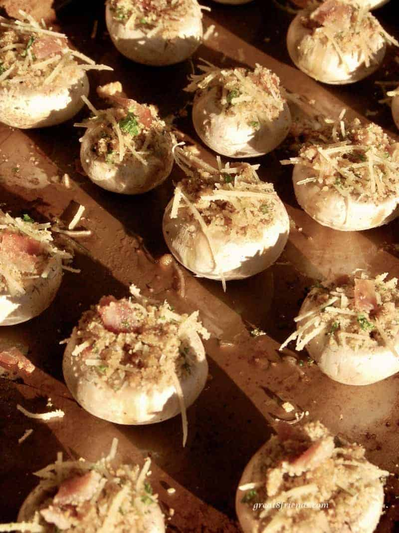 Prosciutto and Parmesan stuffed mushrooms on a baking sheet before baking.
