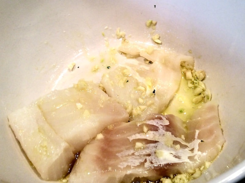 It's so delicious to marinade the cod in olive oil, garlic and fresh lime juice.