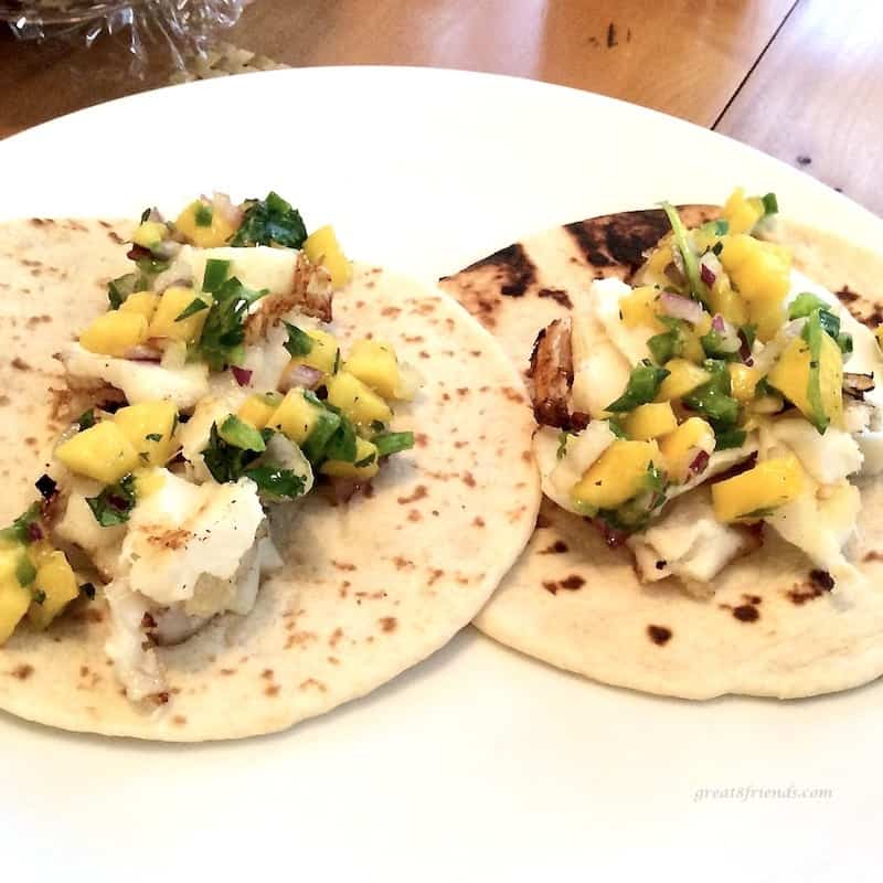 A couple grilled fish tacos with mango salsa is an easy supper.