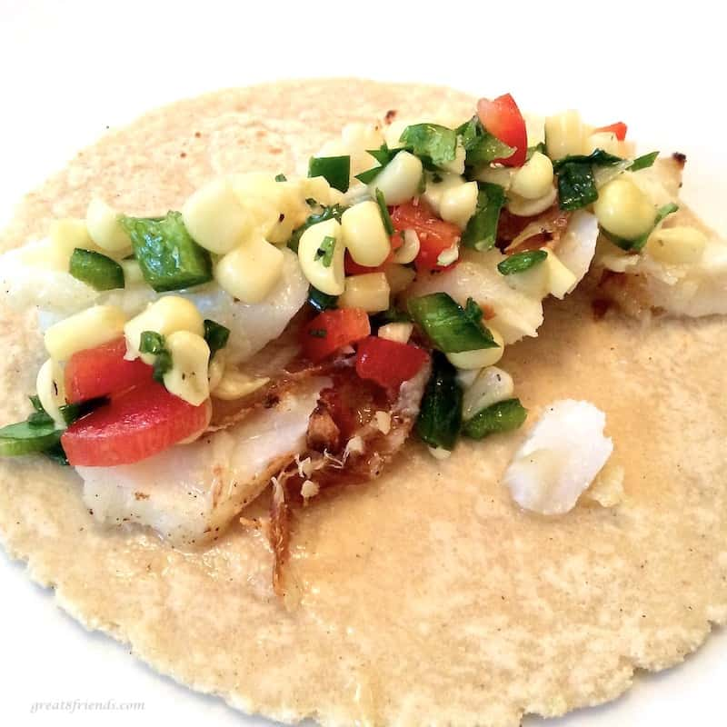 Add some corn salsa on top of the grilled fish and tortillas.
