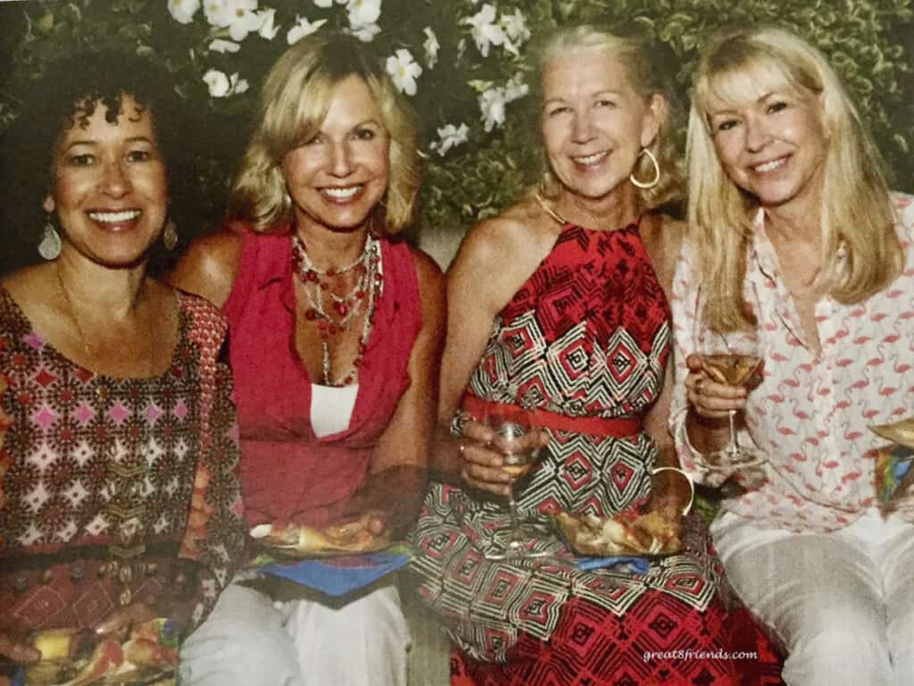 Four ladies in colorful dresses.