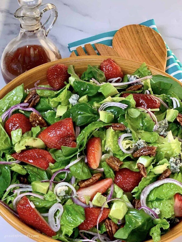 This mixed green salad with strawberries is refreshing and flavorful.