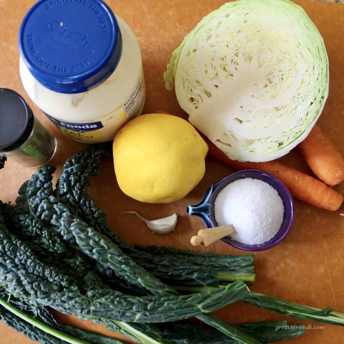 Ingredients to prepare a kale and cabbage slaw with a lemon aioli dressing.