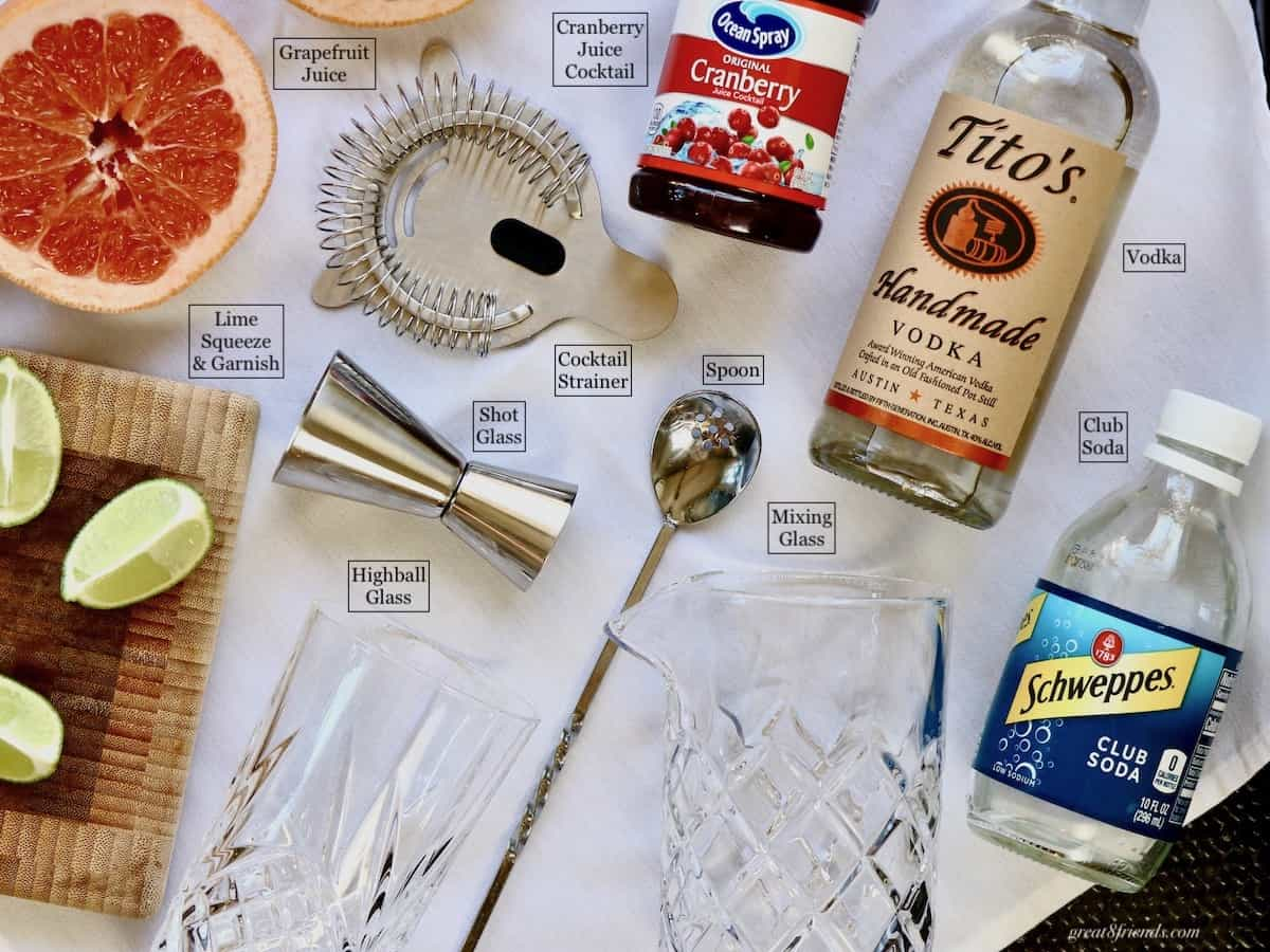 An overhead shot of all the ingredients and equipment for a Nantucket Breeze Cocktail.