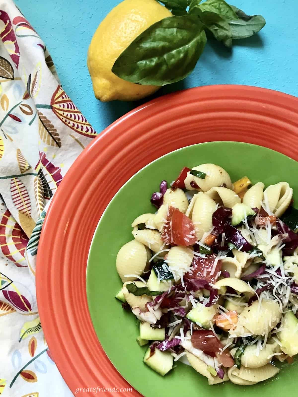 Pasta Salad on a green and red place.