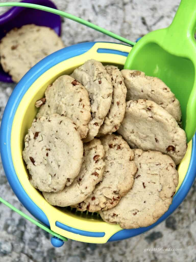 Pecan cookies being served in a sand pail.