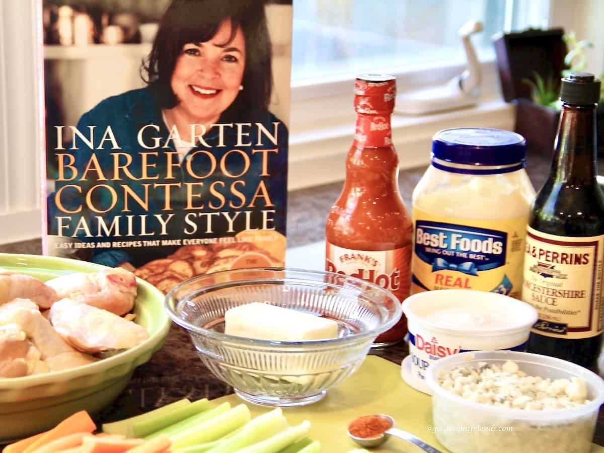 All the ingredients needed for Ina Garten's buffalo chicken wings including the cookbook that the recipe came from.