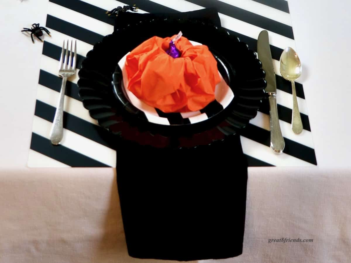 Black white and orange Halloween table setting.
