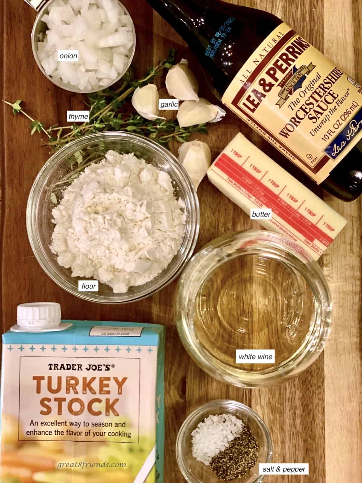 Ingredients laid out including turkey stock, flour, onions, thyme, Worcestershire sauce, butter, salt and pepper.