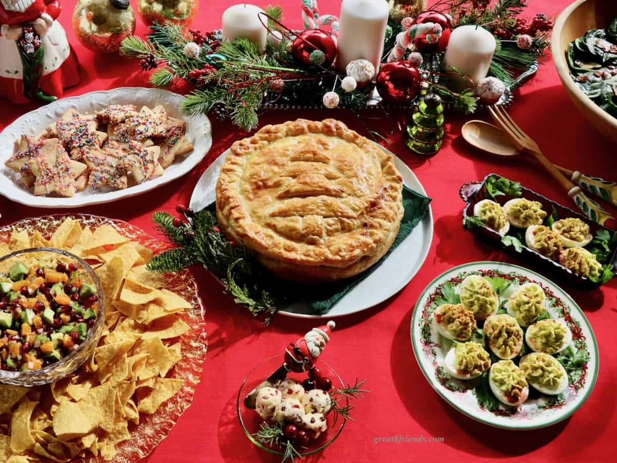 A Christmas brunch buffet on a red tablecloth.