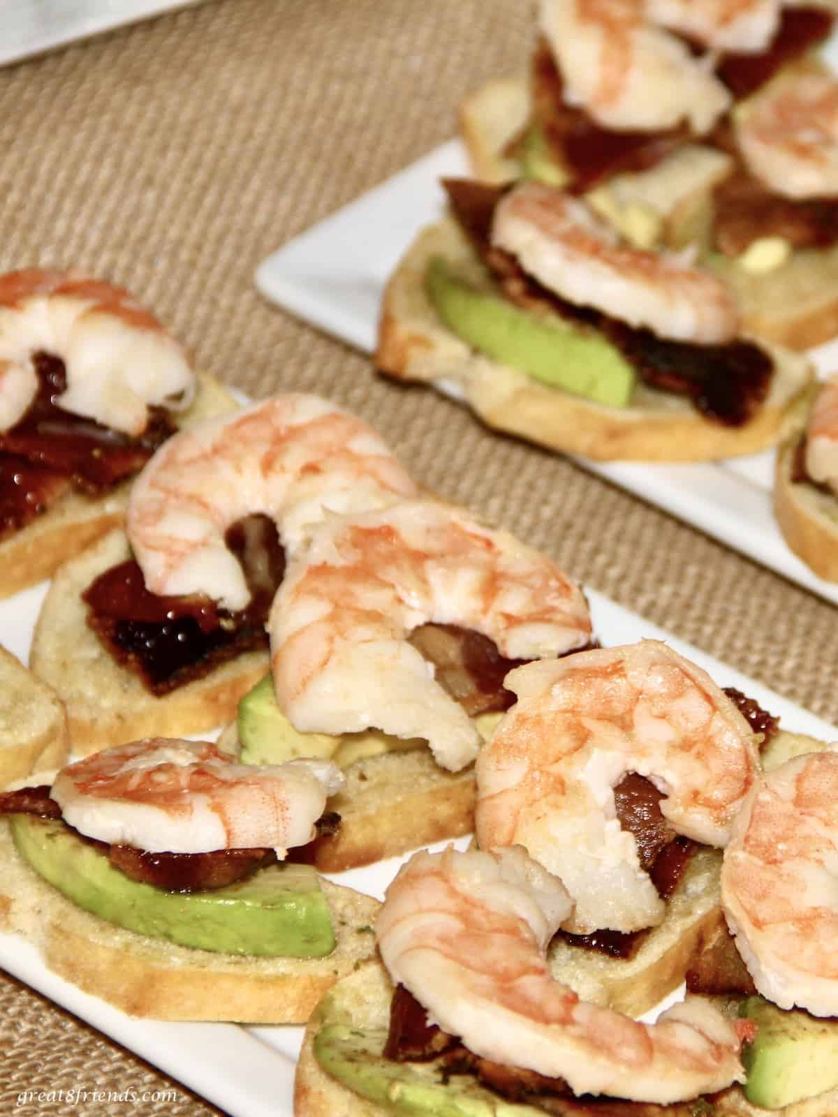 This hearty appetizer includes shrimp, candied bacon and avocado all on a toasted crostini.