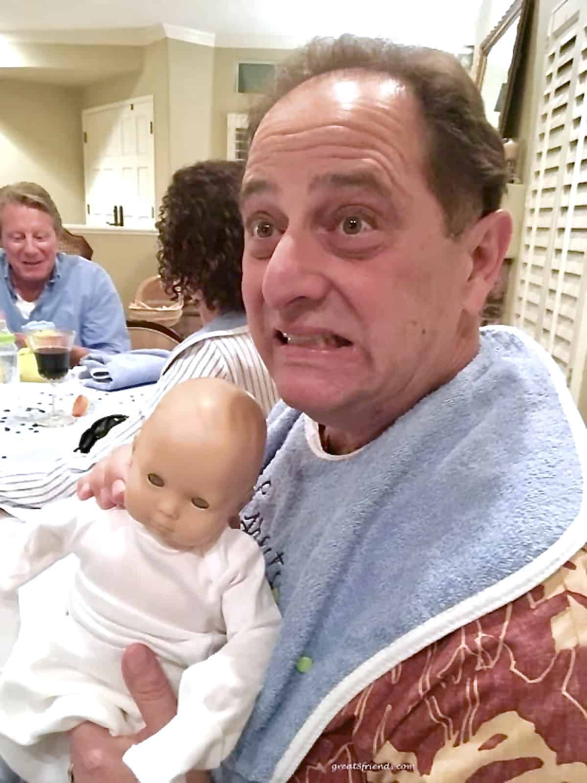 A man holding a baby doll.